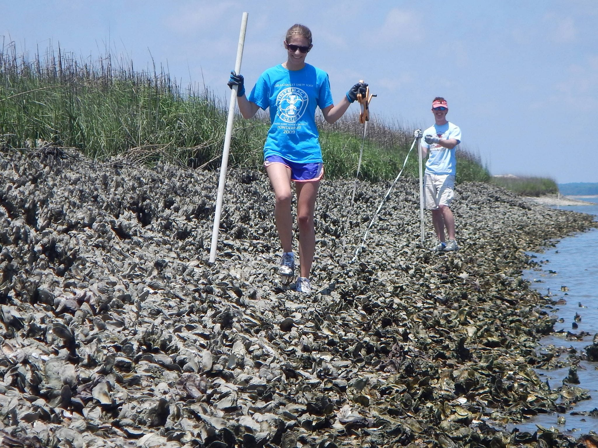 image of students measuring oyster reef